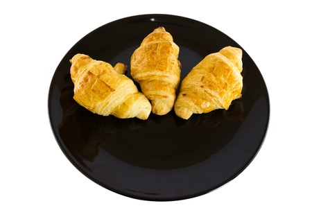 Croissants on a black plate photo