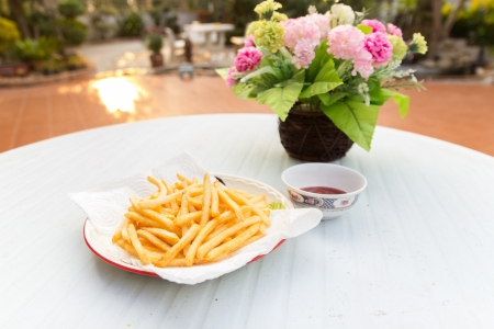 French Fries and flower on a table photo