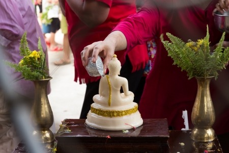 pour water is tradition of ancient Thailand photo