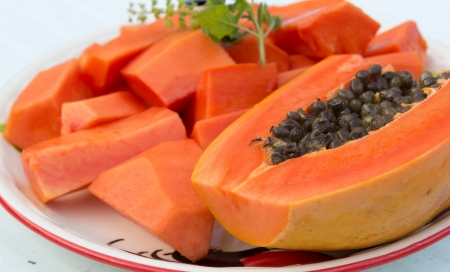 Papaya is a fruit that has a sweet taste Stock Photo
