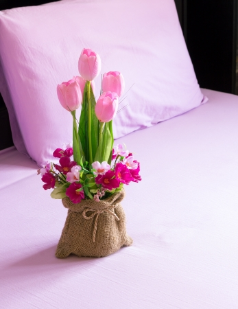 flowers on the bed in a bedroom Stock Photo - 20207894