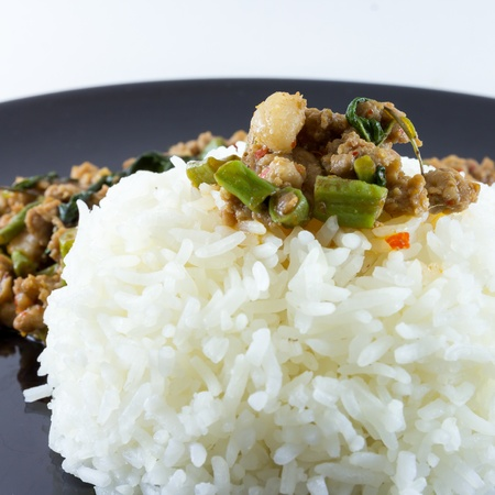 image of Fried basil leave with pork on rice is popular food of the thailand photo
