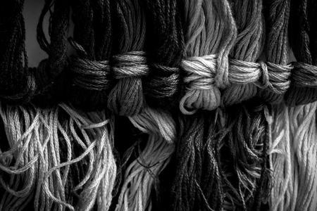 the yarn for Cross Stitch is black white color photo