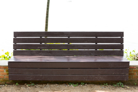 bench in garden of park edge sea for rest photo