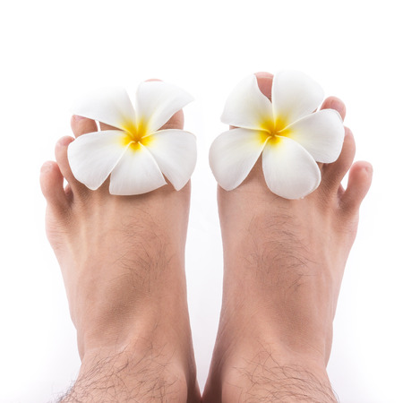 bare foot: the isolated of the foot with frangipani flower in spa on white background