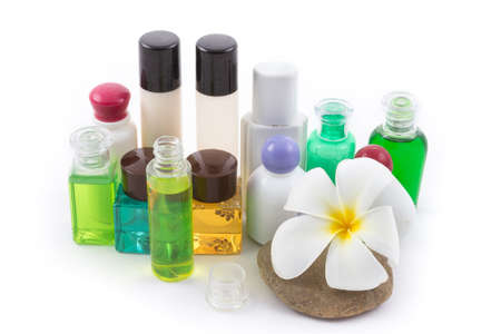 the isolated of the shampoo bottle set with plumeria flower in spa on white background photo