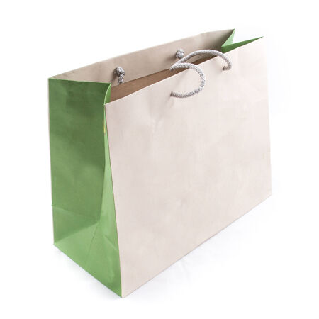 the isolated of the brown paper bag for shopping on a white background photo