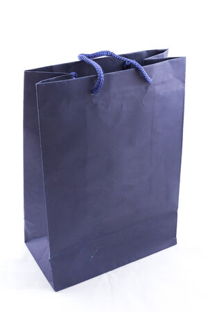 the isolated of the blue paper bag for shopping on a white background photo