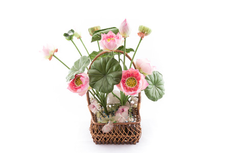 the isolated image of the fake flower with pink lotus on white background photo