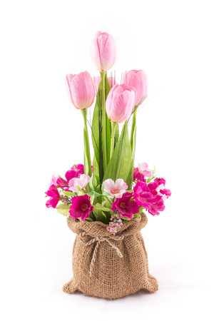 the isolated image of the fake flower with red tulips on white background photo