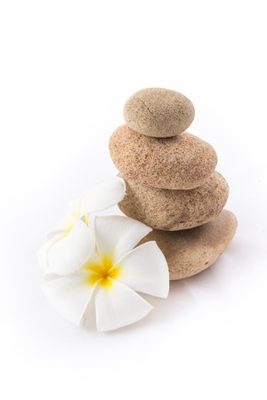 the isolated of the balance stones with Frangipani flower is zen for spa on white background photo