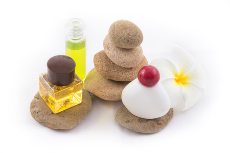the isolated of the balance stones with Frangipani flower and shampoo is zen for spa on white background photo