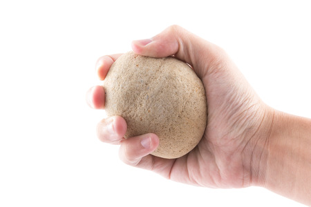 de geïsoleerde van de hand houdt om stenen in de spa op een witte achtergrond Stockfoto