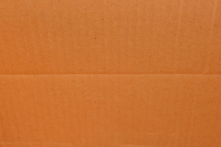 the background, texture of the cardboard is corrugated pattern of brown paper box photo