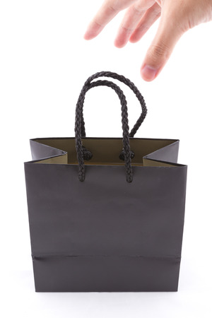the isolated of the black paper bag with carry hand for shopping on a white background photo
