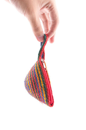 the isolated of the woven bag is rope pattern with hand hold for money pouch on a white background photo