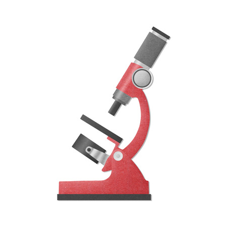 the paper cut of red microscope is science equipment in laboratory for research to medical photo