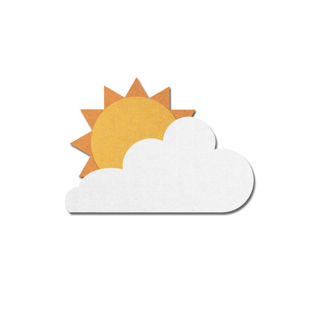 paper cut of sun with clouds on white sky photo