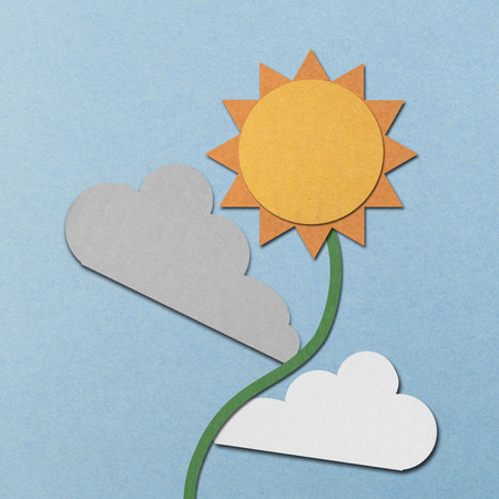 the paper cut of sun and clouds is sunflower on blue sky photo