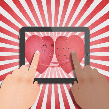 ロマンチックなバレンタインの日の 2 つの赤いハートとタブレット 写真素材