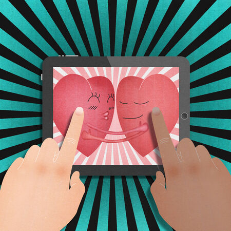 the tablet with two red heart romantic in valentines day Stock Photo