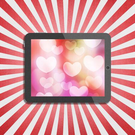 バレンタインの日のタブレット ディスプレイ上心ボケ