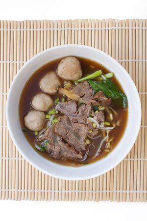 entrails: Chinese clear soup with boiled entrails and vegetables and meat ball Stock Photo