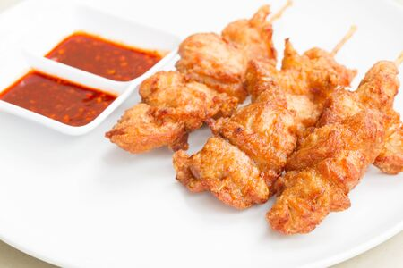 flavoursome: Chicken fried with sauce on white dish is delicious cuisine for fast food.