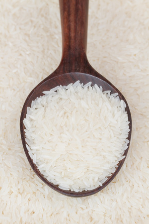 polished: Polished rice on wooden spoon Stock Photo