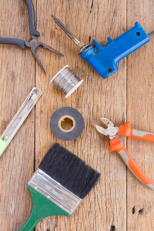 wirecutters: Equipment of tool on wooden background. Stock Photo
