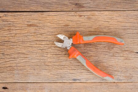 wire cutter: Wire cutter on wood background and space for write messege Stock Photo