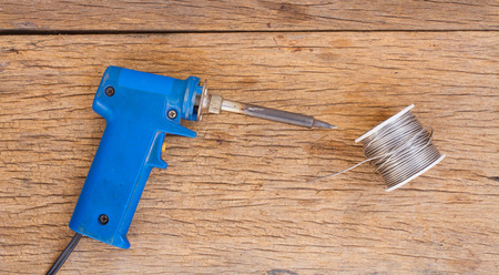 solder: Solder and lead on wooden background