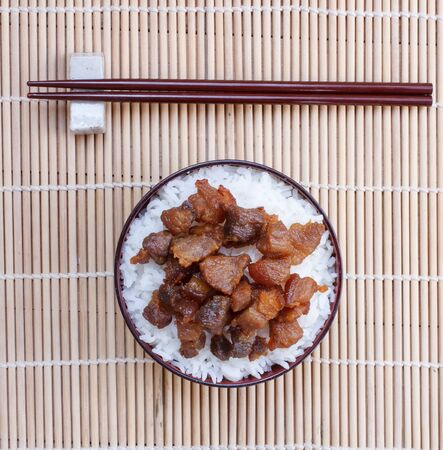 healthy lunch: Rice with fried pork fish sauce on wood background