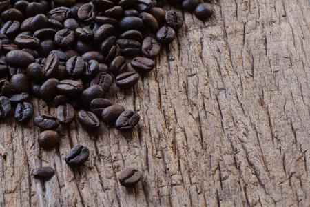 coffe bean: Coffe bean on wood background. Stock Photo