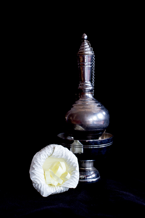 murk: Still life photography by small contrainer and flower on black flannel Stock Photo