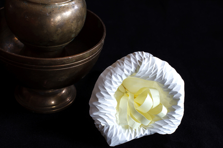 devote: Still life photography by small contrainer and flower on black flannel Stock Photo