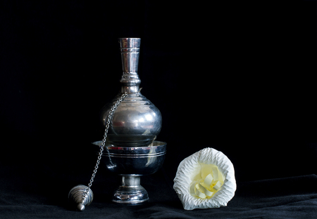 Still life photography by small contrainer and flower on black flannel Stock Photo