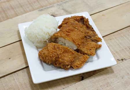 delectable: Crispy fried chicken and sticky rice on wooden table