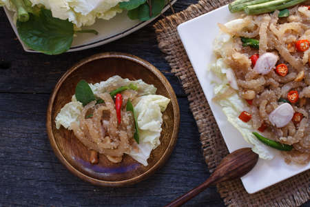 flavorsome: Thai appetizer food called Mooh Nam,  Minced and pounded roasted skin pork,selection focus Stock Photo
