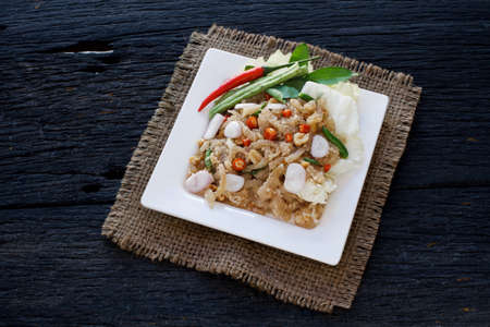 flavorful: Thai appetizer food called Mooh Nam,  Minced and pounded roasted skin pork,selection focus Stock Photo