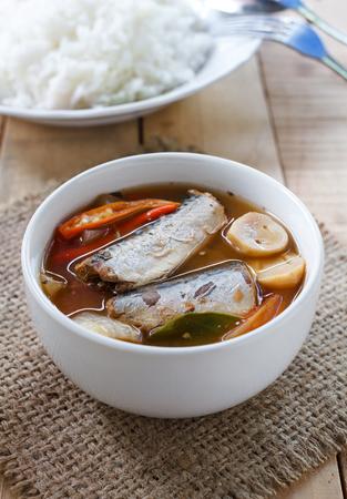 pat: Thai food spicy mackerels fish ,Tom yum canned mackerels in tomato sauce on sackcloth pat. Stock Photo