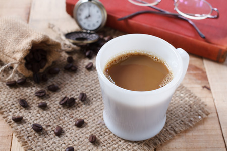 sackcloth: Coffee cup and coffee beans on sackcloth mat, selection focus