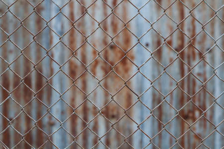 chain link fence: Chain link fence,Rusty wire fence