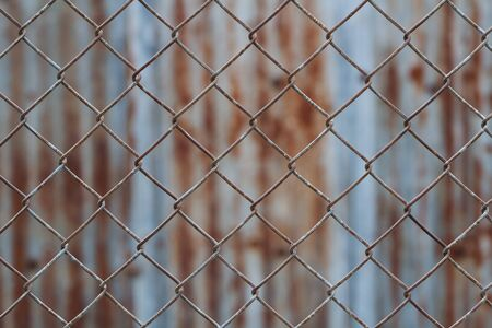 wire fence: Chain link fence,Rusty wire fence
