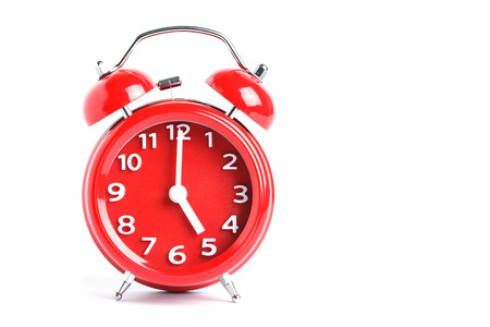 hands  hour: Red double bell alarm clock isolate on white background
