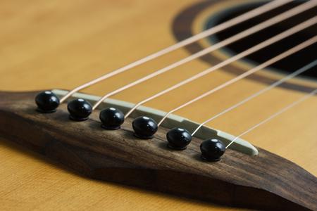 tercet: Still life photo by acoustic guitar bridge, pins and saddle Stock Photo