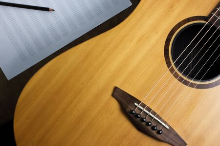 tercet: acoustic guitar and note, selection focus.