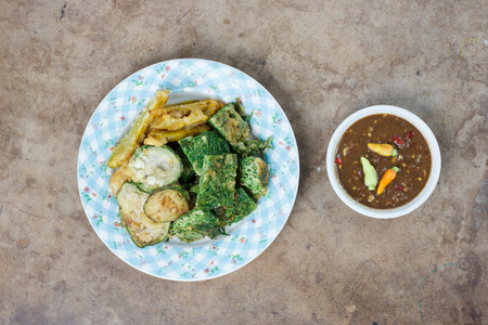 Thai food vegetable fritters and shrimp paste sauce Stock Photo