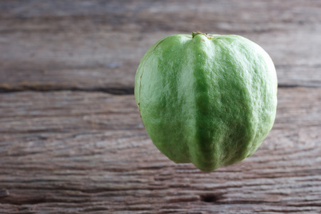 guava fruit: Guava isolated on wood background,Kim cu Stock Photo