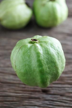 cu: Guava isolated on wood background,Kim cu Stock Photo